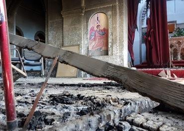 Ei knust kyrkje i Irak etter IS-herjingar.